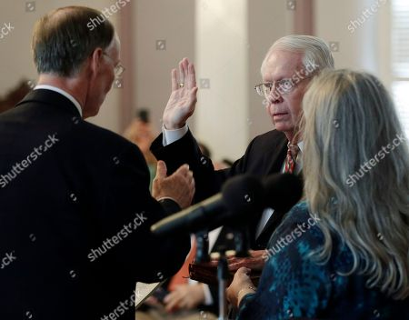 Jim Bennett, Robert Bentley Former Secretary of State Jim Bennett is sworn into office by Gov. Robert Bentley at the Alabama Capitol in Montgomery, Ala., . Bennett replaces Secretary of State Beth Chapman who resigned the position effective Wednesday afternoon. At right Bennett's wife Andrea holds the Bible