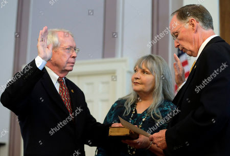 Jim Bennett, Robert Bentley Former Secretary of State Jim Bennett is sworn into office by Gov. Robert Bentley at the Alabama Capitol in Montgomery, Ala., . Bennett replaces Secretary of State Beth Chapman who resigned the position effective Wednesday afternoon. At center is Bennett's wife Andrea