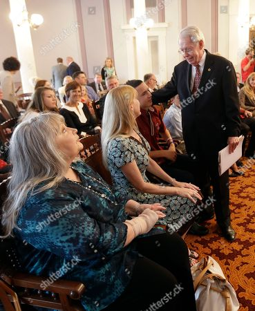 Jim Bennett Former Secretary of State Jim Bennett talks with family members before being sworn into office by Gov. Robert Bentley at the Alabama Capitol in Montgomery, Ala., . Bennett replaces Secretary of State Beth Chapman who resigned the position effective Wednesday afternoon. At left is Bennett's wife Andrea