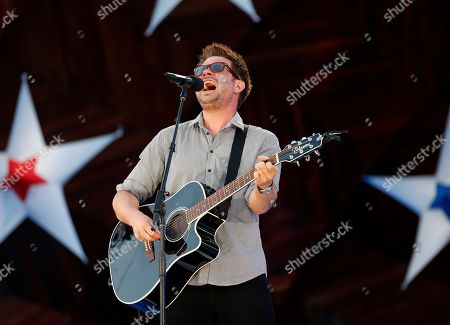 Howie Day Howie Day performs during rehearsal for the Boston Pops Fourth of July concert at the Hatch Shell in Boston