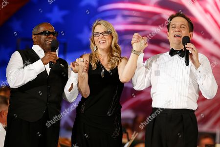 Keith Lockhart, Susan Tedeschi, Ellis Hall Boston Pops conductor Keith Lockhart, right, sings with Ellis Hall, left, and Susan Tedeschi during the finale of the Boston Pops Fourth of July Concert at the Hatch Shell in Boston