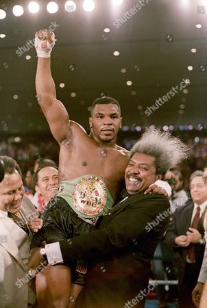 Mike Tyson, Don King Boxing promoter Don King lifts new heavyweight champion Mike Tyson after Tyson defeated Trevor Berbick in Las Vegas. Organizers say seven boxers and 12 others will be the first inductees at the new Nevada Boxing Hall of Fame in Las Vegas. Inductees to be enshrined, in the inaugural class include boxers Tyson, Larry Holmes, Sugar Ray Leonard, Julio Cesar Chavez, Mike McCallum, Diego Corrales and Oscar De La Hoya. King is also to be inducted