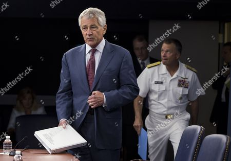 Chuck Hagel, James Winnefeld Defense Secretary Chuck Hagel, followed by Joint Chefs Vice Chairman Adm. James Winnefeld, arrives for a news conference at the Pentagon, . Hagel warned that the Pentagon may have to mothball up to three Navy aircraft carriers and order more sharp reductions in the size of the Army and Marine Corps if Congress does not act to avoid massive budget cuts beginning in 2014