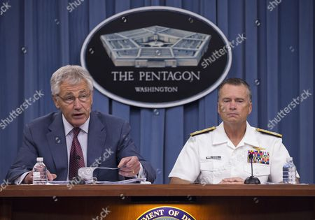 Chuck Hagel, James Winnefeld Defense Secretary Chuck Hagel, accompanied by Joint Chiefs Vice Chairman Adm. James Winnefeld, speaks during a news conference at the Pentagon, . Hagel warned that the Pentagon may have to mothball up to three Navy aircraft carriers and order more sharp reductions in the size of the Army and Marine Corps if Congress does not act to avoid massive budget cuts beginning in 2014