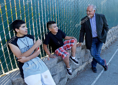 Stock Image of Tony Campos, Brian Chavez, Oscar Gomez This photo shows realtor Tony Campos, right, Watsonville's first Latino elected official, chats with Brian Chavez, center, and Oscar Gomez at an affordable housing complex for farmworkers and their children in Watsonville, Calif. In the bricked plaza, strolling musicians wearing glitzy cowboy outfits blast a mariachi song, while Spanish-speaking shoppers bustle between farm stands choosing tasty cactus leaves and fresh chiles. Welcome to an increasingly typical town in California, a state where Hispanics become the largest ethnic group this summer. As the Golden State becomes less and less white, communities are becoming more segregated, not less