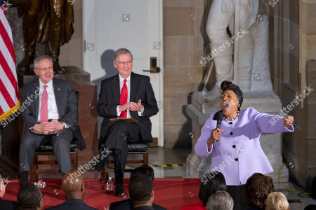 """Harry Reid, Mitch McConnell, Jessye Norman Contemporary opera singer Jessye Norman, right, sings the traditional American spiritual """"He's Got the Whole World in His Hands"""" at a gathering to celebrate the upcoming 50th anniversary of the March on Washington for Jobs and Freedom, at the Capitol in Washington, . Senate Majority Leader Harry Reid, D-Nev., far left, and Senate Minority Leader Mitch McConnell, R-Ky., center left, applaud"""
