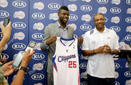 Reggie Bullock, Doc Rivers Reggie Bullock, the Los Angeles Clippers' first-round choice in the 2013 National Basketball Association draft, poses with his jersey as he is joined by head coach Doc Rivers, right, during a news conference in Los Angeles