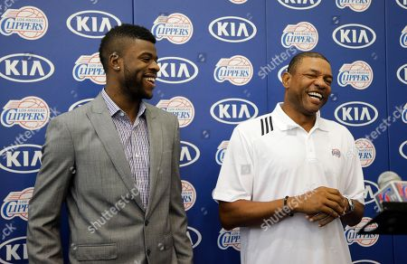 Reggie Bullock, Doc Rivers Los Angeles Clippers head coach Doc Rivers, right, shares a laugh with Reggie Bullock, the Los Angeles Clippers' first-round choice in the 2013 National Basketball Association draft, during a news conference in Los Angeles