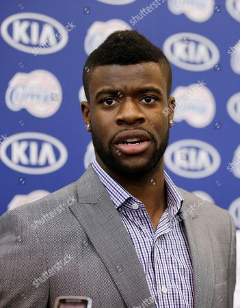 Reggie Bullock Reggie Bullock, the Los Angeles Clippers' first-round choice in the 2013 National Basketball Association draft, talks to reporters during a news conference in Los Angeles