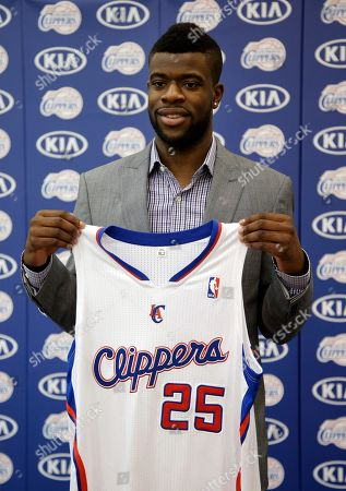 Reggie Bullock Reggie Bullock, the Los Angeles Clippers' first-round choice in the 2013 National Basketball Association draft, poses with his jersey during a news conference in Los Angeles