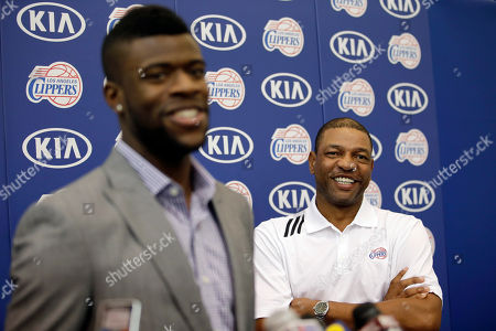 Reggie Bullock, Doc Rivers Los Angeles Clippers head coach Doc Rivers, right, smiles as he listens to Reggie Bullock, the Los Angeles Clippers' first-round choice in the 2013 National Basketball Association draft, during a news conference in Los Angeles