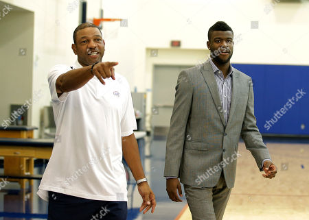 Stock Image of Reggie Bullock, Doc Rivers Reggie Bullock, the Los Angeles Clippers' first-round choice in the 2013 National Basketball Association draft, and head coach Doc Rivers, left, arrive for a news conference in Los Angeles
