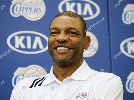 Doc Rivers Los Angeles Clippers head coach Doc Rivers smiles during a news conference held to introduce Reggie Bullock, the Los Angeles Clippers' first-round choice in the 2013 National Basketball Association draft, in Los Angeles