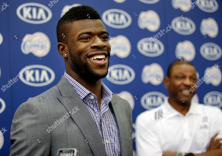Reggie Bullock, Doc Rivers Reggie Bullock, the Los Angeles Clippers' first-round choice in the 2013 National Basketball Association draft, talks to reporters as he is joined by head coach Doc Rivers, background right, during a news conference in Los Angeles