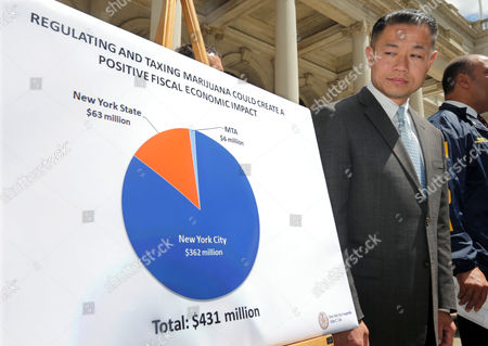 John Liu New York City Comptroller and mayoral candidate John Liu looks at one of his charts on the regulation and taxation of marijuana during a news conference on the steps of New York's City Hall, . Liu is proposing a historic overhaul of the city's marijuana laws, believing that legalizing medical marijuana and allowing adults to possess an ounce of pot for recreational use would pump more than $400 million into the city's coffers