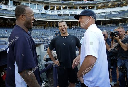 CC Sabathia, Andy Pettitte, Jason Kidd New York Yankees starting pitchers CC Sabathia, left, and Andy Pettitte, center, chat with Brooklyn Nets coach Jason Kidd in between baseball games of a doubleheader against the Los Angeles Dodgers, in New York