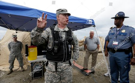 John Batiste, James Bridgman National Guard Lt. Col. James Bridgman, left, explains a drill as Washignton State Patrol Chief John Batiste looks on in Richland, Wash. With the approach of a fire season that is expected to be above average in the state this year, and with a new batch of state officials and staff that came on board when Gov. Jay Inslee was sworn in earlier this year, the state Department of the Military organized a full-day briefing that involved a trip across the mountains to prepare them for their roles during an emergency, and let them know the role and capabilities of the state's National Guard