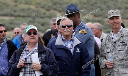 Joel Sacks, Scott Jarvis, Peter Goldmark, John Batiste, Paul D. Gruver State officials watch wild land fire fighting training at the Yakima Training Center near Yakima, Wash. From left are Joel Sacks, Scott Jarvis, Peter Goldmark, Washington State Patrol Chief John Batiste and Brig. Gen. Paul D. Gruver. With the approach of a fire season that is expected to be above average in the state this year, and with a new batch of state officials and staff that came on board when Gov. Jay Inslee was sworn in earlier this year, the state Department of the Military organized a full-day briefing that involved a trip across the mountains to prepare them for their roles during an emergency, and let them know the role and capabilities of the state's National Guard
