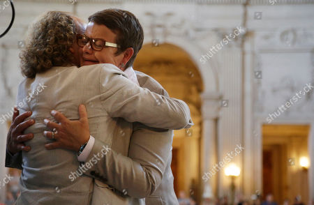 Sandy Stier, Kris Perry Kris Perry, right, is hugged by a supporter after marrying Sandy Stier in a ceremony presided by California Attorney General Kamala Harris at City Hall in San Francisco, . Stier and Perry, the lead plaintiffs in the U.S. Supreme Court case that overturned California's same-sex marriage ban, tied the knot about an hour after a federal appeals court freed same-sex couples to obtain marriage licenses for the first time in 4 1/2 years
