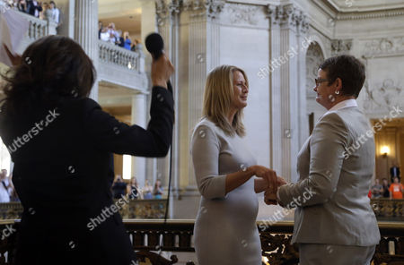 Sany Stier, Kris Perry, Kamala Harris California Attorney General Kamala Harris, left, reacts after conducting the wedding vows of Sandy Stier, center left, and Kris Perry, right, at City Hall in San Francisco, . Stier and Perry, the lead plaintiffs in the U.S. Supreme Court case that overturned California's same-sex marriage ban, tied the knot about an hour after a federal appeals court freed same-sex couples to obtain marriage licenses for the first time in 4 1/2 years