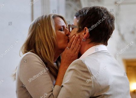 Sandy Stier, Kris Perry Sandy Stier, left, kisses Kris Perry after they were wed by California Attorney General Kamala Harris at City Hall in San Francisco, . Stier and Perry, the lead plaintiffs in the U.S. Supreme Court case that overturned California's same-sex marriage ban, tied the knot about an hour after a federal appeals court freed same-sex couples to obtain marriage licenses for the first time in 4 1/2 years