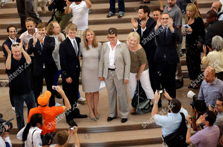 Sandy Stier, Kris Perry Sandy Stier, center left, and Kris Perry, center right, are surrounded by supporters as they attend their wedding ceremony presided by California Attorney General Kamala Harris at City Hall in San Francisco, . Stier and Perry, the lead plaintiffs in the U.S. Supreme Court case that overturned California's same-sex marriage ban, tied the knot about an hour after a federal appeals court freed same-sex couples to obtain marriage licenses for the first time in 4 1/2 years