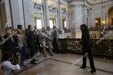 Sany Stier, Kris Perry, Kamala Harris Sandy Stier, center left, and Kris Perry are greeted with applause as they prepare to be wed by California Attorney General Kamala Harris at City Hall in San Francisco, . Stier and Perry, the lead plaintiffs in the U.S. Supreme Court case that overturned California's same-sex marriage ban, tied the knot at San Francisco City Hall on Friday, about an hour after a federal appeals court freed same-sex couples to obtain marriage licenses for the first time in 4 1/2 years