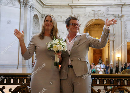 Sandy Stier, Kris Perry Sandy Stier, left, and Kris Perry wave at supporters after they were wed by California Attorney General Kamala Harris at City Hall in San Francisco, . Stier and Perry, the lead plaintiffs in the U.S. Supreme Court case that overturned California's same-sex marriage ban, tied the knot about an hour after a federal appeals court freed same-sex couples to obtain marriage licenses for the first time in 4 1/2 years