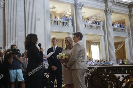 Sany Stier, Kris Perry, Kamala Harris Sandy Stier, center left, and Kris Perry, at right, exchange wedding vows in front of California Attorney General Kamala Harris, left, at City Hall in San Francisco, . Stier and Perry, the lead plaintiffs in the U.S. Supreme Court case that overturned California's same-sex marriage ban, tied the knot about an hour after a federal appeals court freed same-sex couples to obtain marriage licenses for the first time in 4 1/2 years