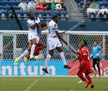 Frederic Piquionne, Olivier Thomert Martinique's Frederic Piquionne (9) and Olivier Thomert (13) leap for a header as Panama's Marcos Sanchez watches at right in the first half of a CONCACAF Gold Cup soccer match, in Seattle
