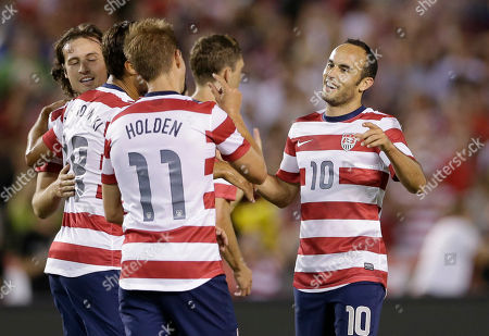 Landon Donovan, Stuart Holden The United States' Landon Donovan, right, jokes with teammate Stuart Holden (11) after the team's fourth goal against Guatemala in the second half during an international friendly soccer match, in San Diego