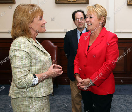 Gov. Maggie Hassan, D-N.H., left, meets with Quebec's premier, Pauline Marois, at the Statehouse, in Concord, N.H