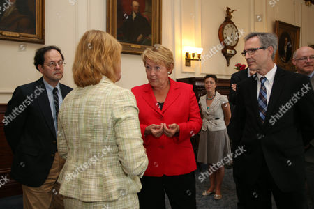 Gov. Maggie Hassan, D-N.H., back to camera, meets with Quebec's premier, Pauline Marois, at the Statehouse, in Concord, N.H