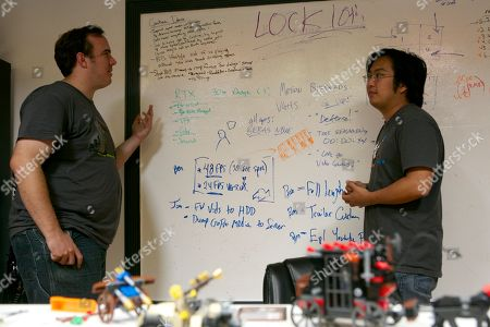 Matt Arnold, Freddie Wong Rocket Jump Studios co-founders and partners: Matt Arnold, left, and Freddie Wong pose for a photo at their studio in Burbank, Calif. Rocket Jump Studios in collaboration with Collective Digital Studio will unleash the anticipated second season of the breakout online action-comedy scripted series Video Game High School on RocketJump.com and YouTube. The new season, from Freddie Wong, co-creator of the YouTube phenomenon that is FreddieW, and Matt Arnold, VGHS co-creator and co-founder of RocketJump.com, follows the blockbuster first season - which garnered more than 55 million views across its nine episodes and behind-the-scenes content to rank among the most watched original scripted digital short-form series of all-time