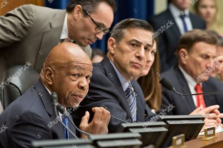 Darrell Issa, Elijah Cummings, John Mica The House Oversight Committee, led by Chairman Darrell Issa, R-Calif., center, meets in a politically contentious session to vote on whether to compel Internal Revenue Service official Lois Lerner to testify about the extra scrutiny the IRS gave to tea party and other conservative groups that applied for tax-exempt status, on Capitol Hill in Washington, in Washington, . At left is Rep. Elijah Cummings, D-Md., the ranking member, Rep. John L. Mica, R-Fla., listens at right. Lerner, the IRS supervisor who headed the tax-exempt division, appeared before the Republican-controlled panel with her attorney May 22 but cited her constitutional right to not answer questions and left after a dramatic standoff. The Oversight Committee contends Lerner forfeited her right to remain silent by making opening remarks at last month's hearing
