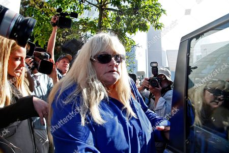 Debbie Rowe Debbie Rowe, Michael Jackson's former wife and mother of two of his children, leaves Los Angeles County Superior Court after testifying in the negligence lawsuit filed by Jackson's mother, Katherine Jackson, against AEG Live, in Los Angeles. Rowe told a Los Angeles jury on Thursday, Aug. 15, 2013, that injuries and medical conditions left the singer feeling disfigured and forced him to wear wigs and de-pigment his skin. These difficult treatments she said were made harder by Jackson's superstar status