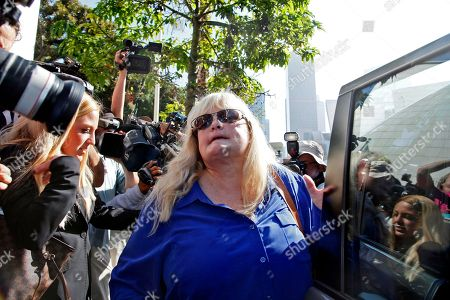 Debbie Rowe Debbie Rowe, Michael Jackson's former wife and mother of two of his children, leaves Los Angeles County Superior Court after testifying in the negligence lawsuit filed by Jackson's mother, Katherine Jackson, against AEG Live, in Los Angeles. Rowe broke into tears when she took the witness stand in the civil case and described the singer's fear of pain and reliance on physicians. She said the pop star trusted doctors to prescribe pain medication to him, but they sometimes tried to outdo each other while losing sight of Jackson's care