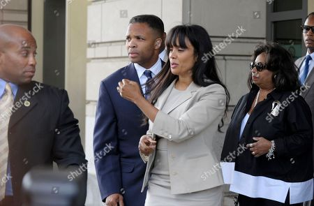 Jesse Jackson Jr., Sandra Jackson Former Illinois Rep. Jesse Jackson Jr., and his wife Sandra, leaves federal court in Washington, . Jackson was sentenced to two and a half years in prison Wednesday after pleading guilty to scheming to spend $750,000 in campaign funds on TV's, restaurant dinners, an expensive watch and other costly personal items. His wife received a sentence of one year