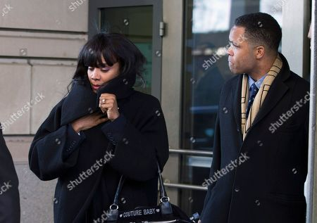 Stock Image of Jesse Jackson Jr., Sandi Jackson Former Illinois Rep. Jesse Jackson Jr. and his wife Sandi leave federal court in Washington. On, U.S. District Judge Amy Berman Jackson set a new sentencing date of Aug. 14 for Jackson and his wife. Jackson pleaded guilty this year to spending $750,000 in campaign funds on personal items, including mounted elk heads and a gold-plated Rolex watch. His wife, former Chicago alderman Sandi Jackson, pleaded guilty to filing false joint tax returns. They had been scheduled for sentencing Wednesday, July 3. But Berman postponed the hearing on Monday to accommodate the court