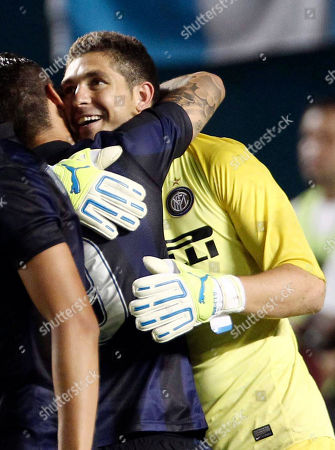 Juan Pablo Carrizo, Mauro Icardi Inter Milan goalkeeper Juan Pablo Carrizo, right, is congratulated by teammate Mauro Icardi, after Carrizo scored the game-winning penalty kick against Juventus in an International Champions Cup soccer match, in Miami