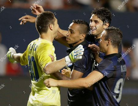 Juan Pablo Carrizo Inter Milan goalkeeper Juan Pablo Carrizo, left, is congratulated by his teammates after winning the game with a penalty kick against Juventus in an International Champions Cup soccer match, in Miami