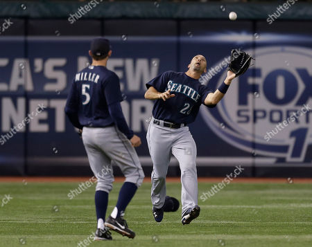 Raul Ibanez, Brad Miller Seattle Mariners left fielder Raul Ibanez makes the catch on a fourth-inning flyout by Tampa Bay Rays' Luke Scott during a baseball game, in St. Petersburg, Fla. Looking on is Mariners' Brad Miller
