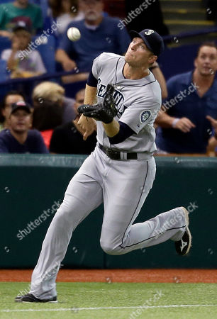 Michael Saunders Seattle Mariners left fielder Michael Saunders chases down a fly ball by Tampa Bay Rays' Luke Scott during the fourth inning of a baseball game, in St. Petersburg, Fla