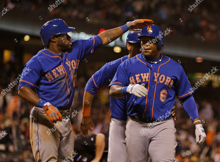Eric Young Jr., Marlon Byrd New York Mets' Marlon Byrd, right, is greeted by teammate Eric Young Jr., left, after hitting a grand slam home run to left field off San Francisco Giants relief pitcher Jake Dunning in the eighth inning of their baseball game, in San Francisco