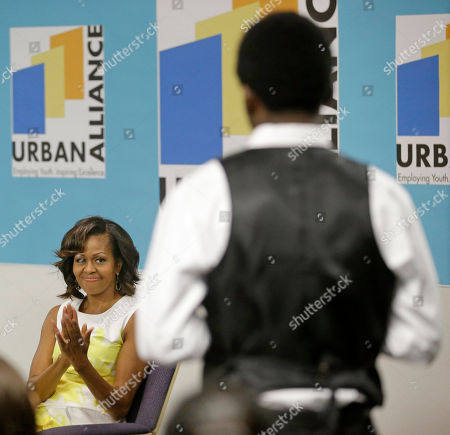 Michelle Obama, Steven O'Neal First lady Michelle Obama listens to Steven O'Neal, and other Chicago teens participating in Urban Alliance, a career training program run by Mayor Rahm Emanuel's wife Amy Rule, in Chicago. Urban Alliance is a nonprofit group that helps students from disadvantaged backgrounds with vocational training