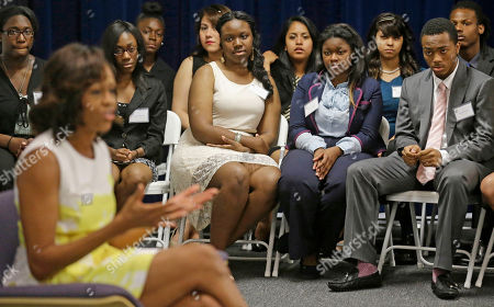 Michelle Obama First lady Michelle Obama talks with Chicago teens participating in Urban Alliance, a career training program run by Mayor Rahm Emanuel's wife Amy Rule, in Chicago. Urban Alliance is a nonprofit group that helps students from disadvantaged backgrounds with vocational training