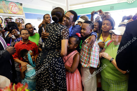 """Michelle Obama, Dwight Henry First lady Michelle Obama hugs actor Dwight Henry, who starred in the movie """"Beasts of the Southern Wild,"""" while visiting Sterling Farms Grocery Store in Marrero, La., . The store was opened last year by actor Wendell Pierce as part of the """"Alliance For A Healthier Generation."""" Earlier she spoke about childhood obesity at the annual meeting of the National Council of La Raza"""