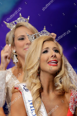 Stock Picture of Amy Crain, right, is crowned Miss Arkansas 2013 by Sloane Roberts, the 2012 Miss Arkansas at the Miss Arkansas Pageant in Hot Springs, Ark