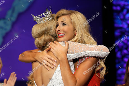 Stock Photo of Amy Crain, right, is hugged by Sloane Roberts as Crain is named Miss Arkansas 2013 at the Miss Arkansas Pageant in Hot Springs, Ark