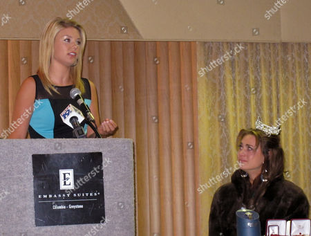 Stock Image of Miss South Carolina 2012, Ali Rogers, left, tells Miss South Carolina 2013, Brooke Mosteller, right, that she will represent South Carolina well during a news conference, in Columbia, S.C. Mosteller won the crown as Miss Mount Pleasant and will compete in the Miss America pageant in September